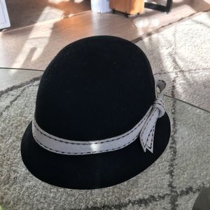 Black and white boiled will cloche hat.